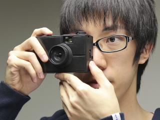 它只是一台可換鏡頭的模型相機而已